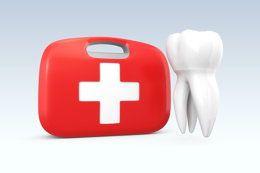 Red dental emergency kit next to a white tooth to indicate a dental emergency in Cedar Park, TX