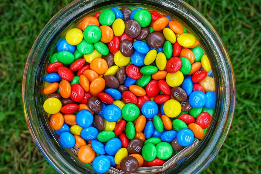 a bowl of m&m candies